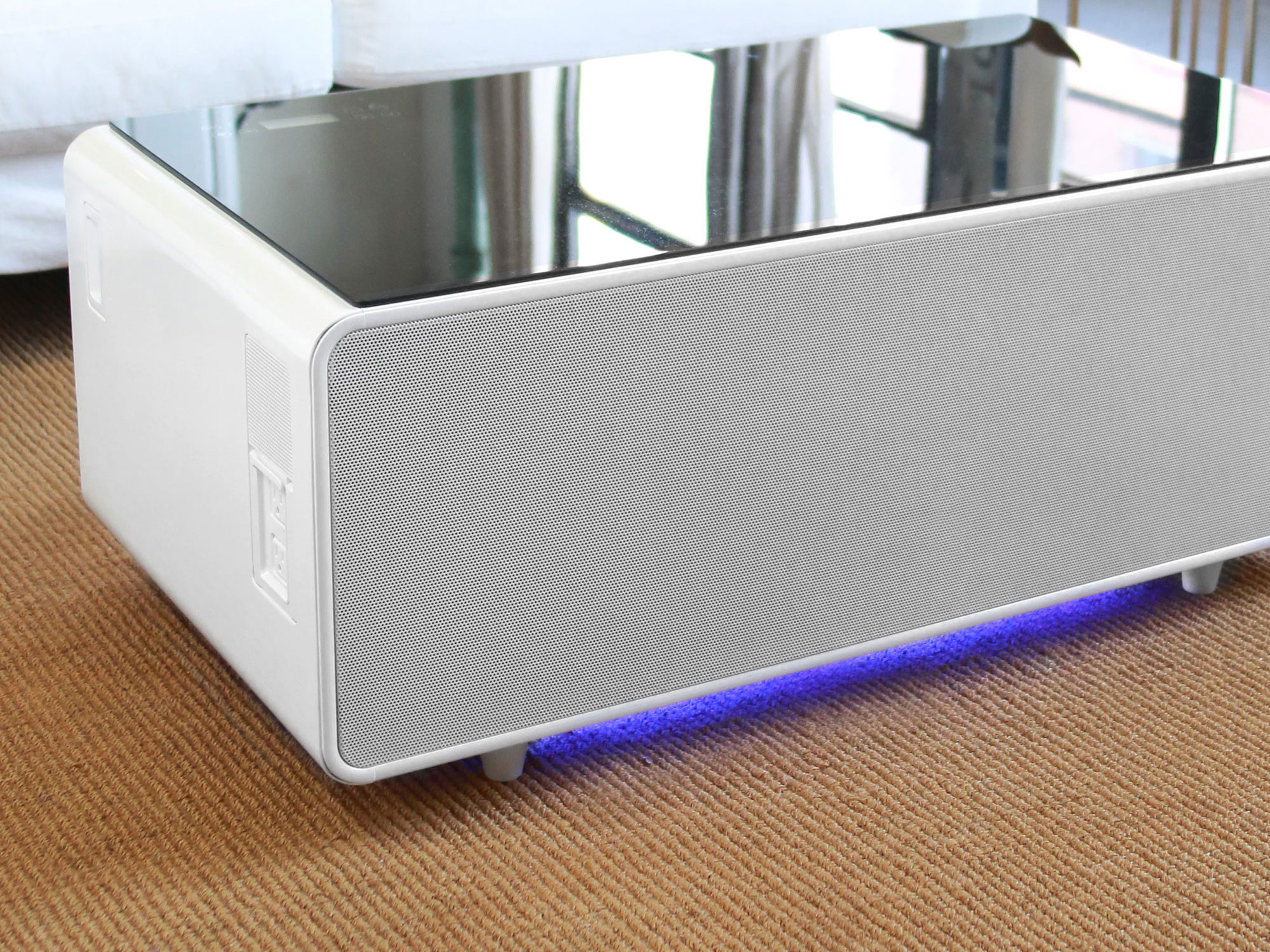White Sobro smart coffee table with speakers and underlit base.